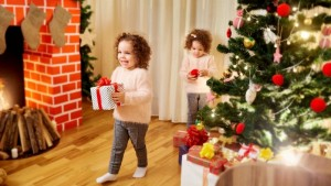 Children with gifts at Christmas, New Year's in the room with th